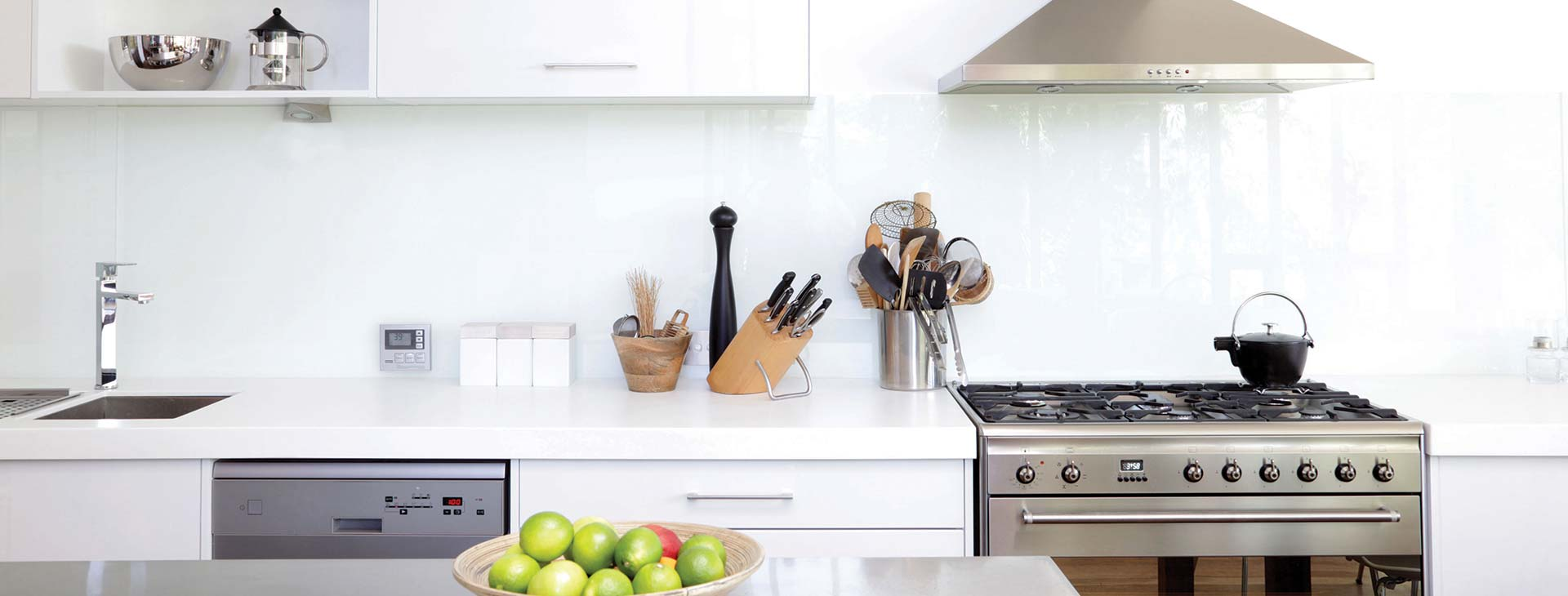 Beautiful white kitchen with stainless steel appliances and accessories