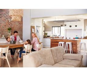Family enjoying a meal together set in an accessorised kitchen