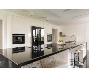 Modern cream kitchen with stylish black appliances