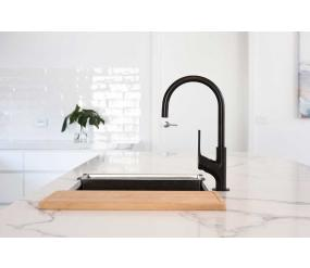 Stone benchtop with feature black tapware