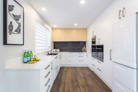 white wood feature kitchen